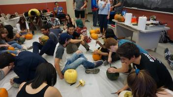 Members carving pumpkins!