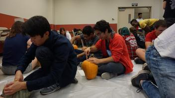 Members focusing on their carving skills!
