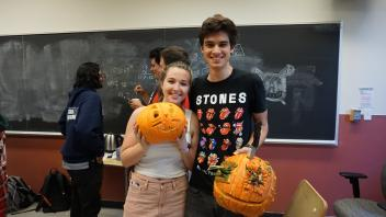 Connor Lyon and Amanda with their carved pumpkins!