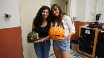 Sarah and her friend showing off their pumpkins!