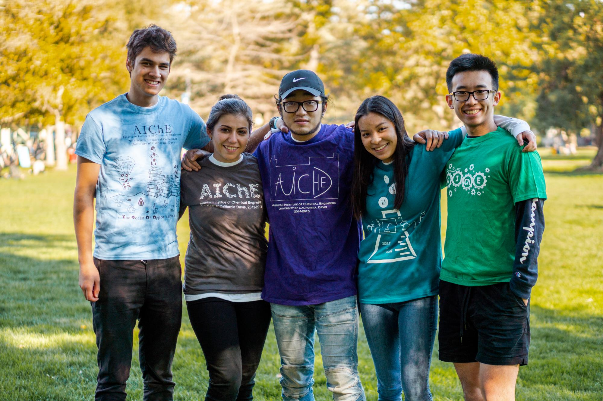 AIChE officers showing off club shirts
